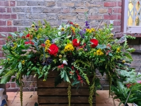 Colourful and vivid casket spray